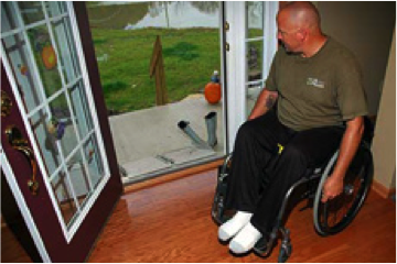 Photo of man in wheelchair looking outside