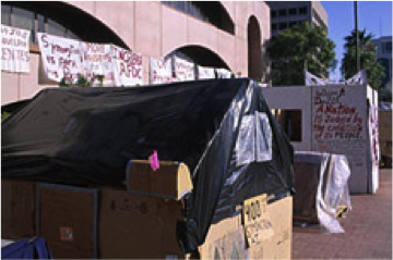 Photo of tent in homeless camp